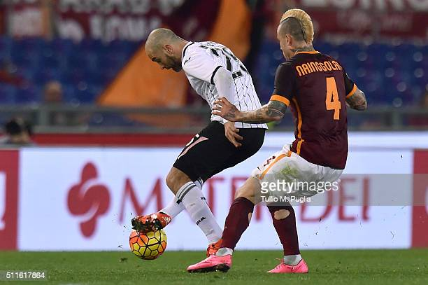 Enzo Maresca of Palermo is challenged by Radja Nainggolan of Roma during the Serie A match between AS Roma and US Citta di Palermo at Stadio Olimpico...