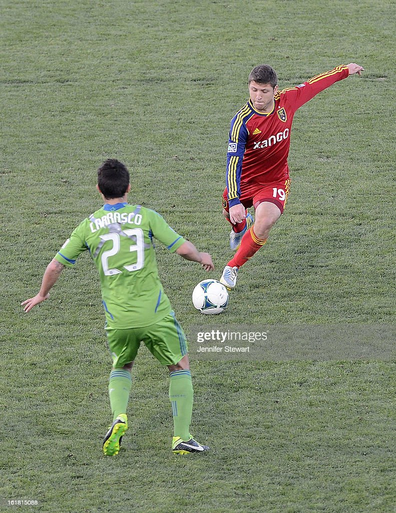 Enzo Martinez #19 of Real Salt Lake handles the ball against Servando Carrasco #23 of the Seattle Sounders during the second half at FC Tucson Desert Diamond Cup at Kino Sports Complex on February 16, 2013 in Tucson, Arizona. Seattle Sounders defeated Real Salt Lake 2-1.