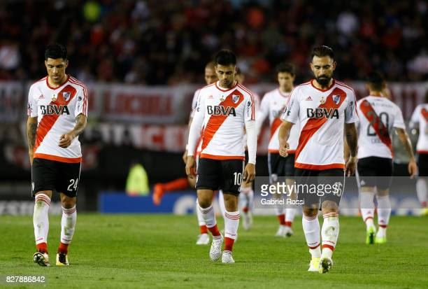 Enzo Perez Gonzalo Martinez and Ariel Rojas of River Plate leave the field at the end of the first half during a second leg match between River Plate...