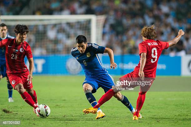 Enzo Perez of Argentina and Wai Lim Lee of Hong Kong in action during the International Friendly Match between Hong Kong and Argentina at the Hong...