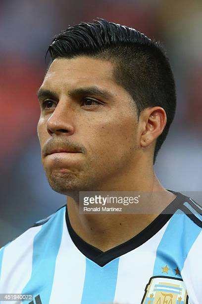Enzo Perez of Argentina looks on during the National Anthem prior to the 2014 FIFA World Cup Brazil Semi Final match between the Netherlands and...