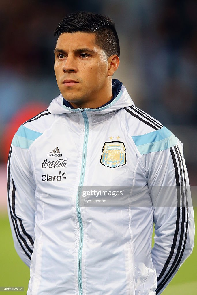 <a gi-track='captionPersonalityLinkClicked' href=/galleries/search?phrase=Enzo+Perez&family=editorial&specificpeople=3275855 ng-click='$event.stopPropagation()'>Enzo Perez</a> of Argentina stands during the playing of national anthems prior to the International Friendly between Argentina and Croatia at Boleyn Ground on November 12, 2014 in London, England.