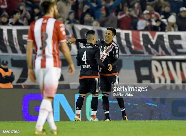 Enzo Perez of River Plate celebrates with teammate Jorge Moreira after scoring the second goal of his team during a match between River Plate and...