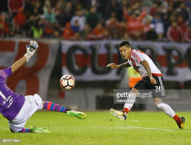 Enzo Perez of River Plate kicks the ball to score the fourth goal of his team during a second leg match between River Plate and Wilstermann as part...