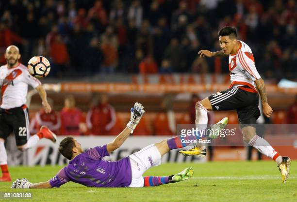 Enzo Perez of River Plate kicks the ball to scores the eighth goal of his team during a second leg match between River Plate and Wilstermann as part...