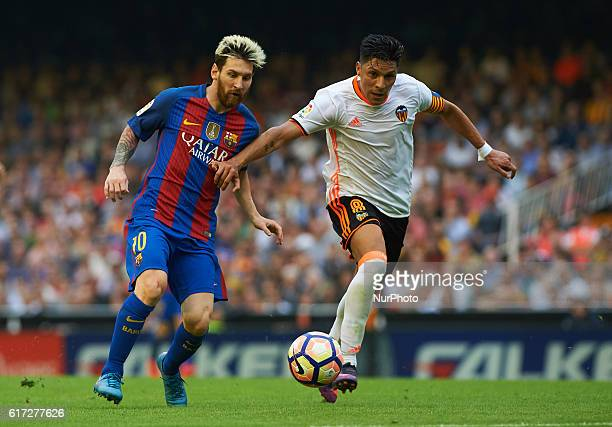Enzo Perez of Valencia CF and Leo Messi of FC Barcelona during the La Liga match between Valencia CF vs FC Barcelona at Mestalla Stadium Valencia on...
