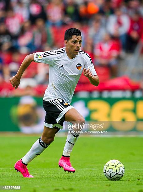 Enzo Perez of Valencia CF controls the ball during the La Liga match between Sporting Gijon and Valencia CF at Estadio El Molinon on September 12...