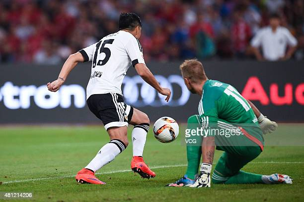 Enzo Perez of Valencia Club and Yoel Rodriguez of Valencia Club control the ball during the match between FC Bayern Munchen and Valencia Club on day...