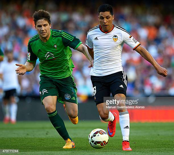 Enzo Perez of Valencia competes for the ball with Andreu Fontas of Celta de Vigo during the La Liga match between Valencia CF and Celta de Vigo at...