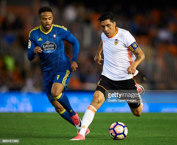 Enzo Perez of Valencia competes for the ball with Theo Bongonda of Celta de Vigo during the La Liga match between Valencia CF and RC Celta de Vigo at...