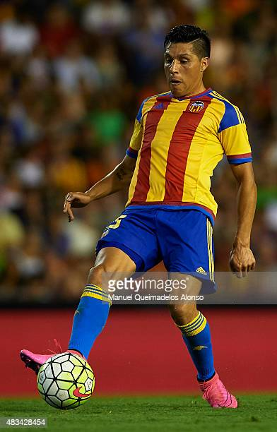 Enzo Perez of Valencia controls the ball during the preseason friendly match between Valencia CF and AS Roma at Estadio Mestalla on August 8 2015 in...