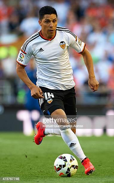 Enzo Perez of Valencia runs with the ball during the La Liga match between Valencia CF and Celta de Vigo at Estadi de Mestalla on May 17 2015 in...
