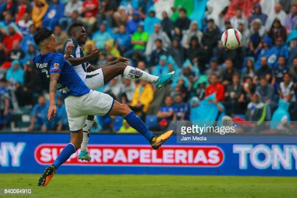 Enzo Roco of Cruz Azul fights for the ball with Aviles Hurtado of Monterrey during the seventh round match between Cruz Azul and Monterrey as part of...