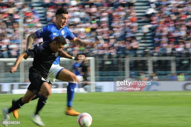Enzo Roco of Cruz Azul vies for the ball with Orbelin Pineda of Guadalajara as part of the Torneo Apertura 2017 Liga MX at Azul Stadium on July 29...