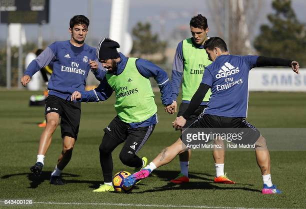 Enzo Zidane Isco Mateo Kovacic and James Rodriguez of Real Madrid in action during a training session at Valdebebas training ground on February 21...