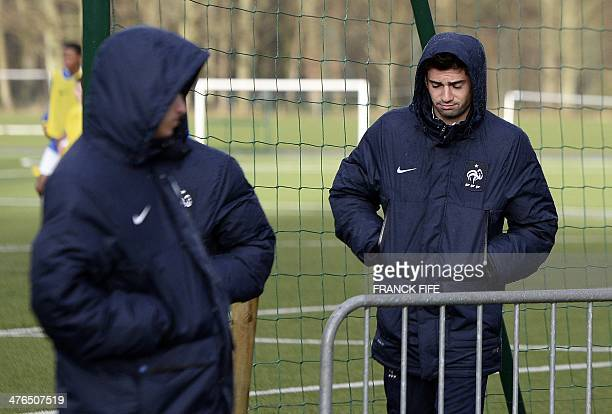 Enzo Zidane the 18yearold son of French legend Zinedine Zidane who plays in the youth team of Real Madrid walks with players of the France U19 team...