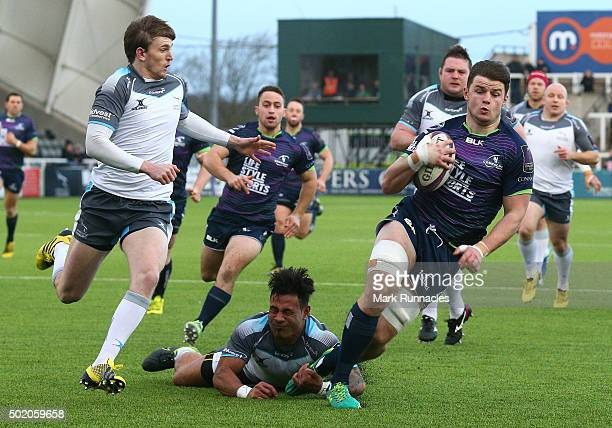 Eoghan Masterson of Connacht Rugby is tackled by Simon Hammersley and Sonatane Takulua of Newcastle Falcons just short of the try line during the...