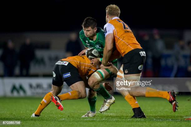 Eoghan Masterson of Connacht tackled by Rynier Bernardo during the Guinness PRO14 Round 8 rugby match between Connacht Rugby and Toyota Cheetahs at...