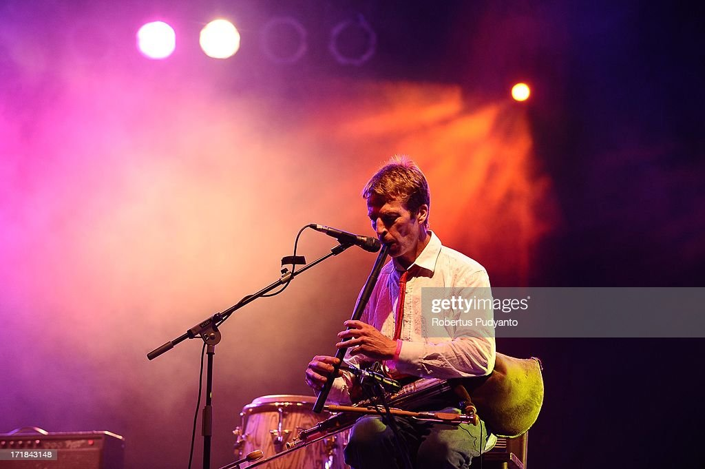 Eoin Dillon of Kila (Ireland) playing tin whistle and uillean pipe, featuring songs based on gorgeous traditional Irish melodies, percussive like singing and driving rhythms in Rainforest World Music Festival at Sarawak Cultural Village on June 28, 2013 in Kuching, Sarawak, Malaysia.