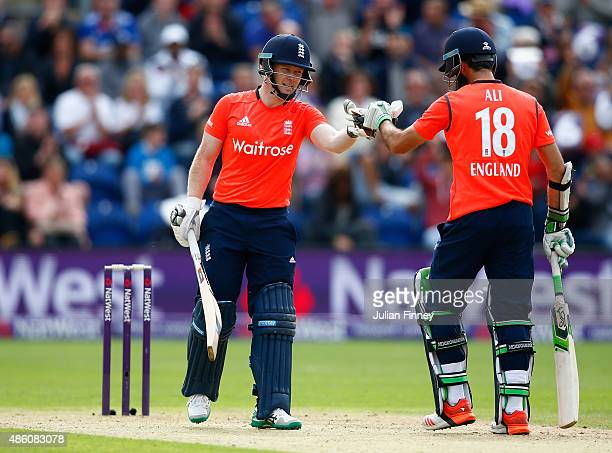 Eoin Morgan and Moeen Ali of England support each other during the NatWest T20 International match between England and Australia at SWALEC Stadium on...