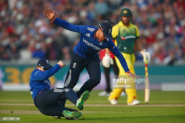 Eoin Morgan of England catches and dismisses Joe Burns of Australia as Jason Roy of England avoids colliding with him during the 3rd Royal London...
