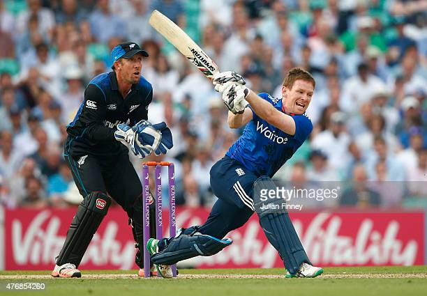 Eoin Morgan of England hits out as Luke Ronchi of New Zealand watches on during the 2nd ODI Royal London OneDay Series 2015 at The Kia Oval on June...