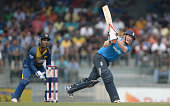 Eoin Morgan of England hits out for 6 runs during the 4th One Day International match between Sri Lanka and England at R Premadasa Stadium on...