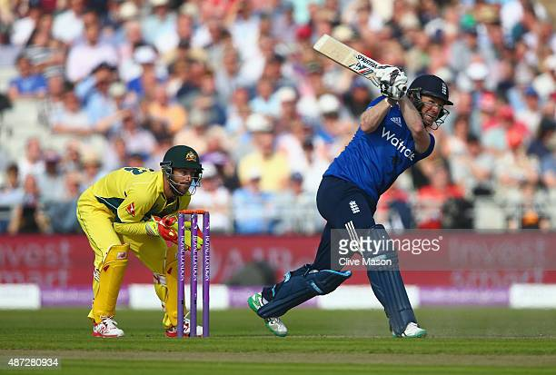 Eoin Morgan of England in action batting as Matthew Wade of Australia looks on during the 3rd Royal London OneDay International match between England...