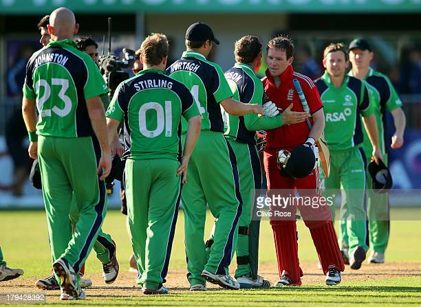 Eoin Morgan of England is congratulated by the Irish team after hitting the winning runs in the RSA Challenge One Day International match between...