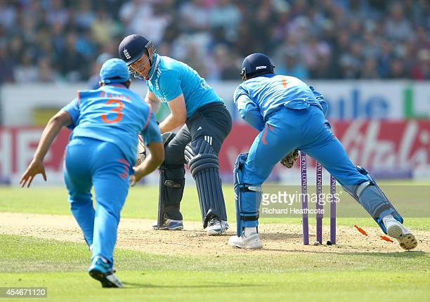 Eoin Morgan of England is stumped by MS Dhoni of India off the bowling of Ravi Ashwin during the Royal London OneDay match between England and India...