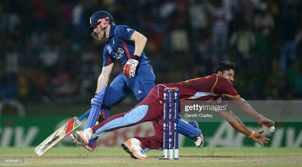 <a gi-track='captionPersonalityLinkClicked' href=/galleries/search?phrase=Eoin+Morgan&family=editorial&specificpeople=689581 ng-click='$event.stopPropagation()'>Eoin Morgan</a> of England makes his ground underpressure from <a gi-track='captionPersonalityLinkClicked' href=/galleries/search?phrase=Ravi+Rampaul&family=editorial&specificpeople=2924536 ng-click='$event.stopPropagation()'>Ravi Rampaul</a> of the West Indies during the ICC World Twenty20 2012 Super Eights Group 1 match between England and the West Indies at Pallekele Cricket Stadium on September 27, 2012 in Kandy, Sri Lanka.