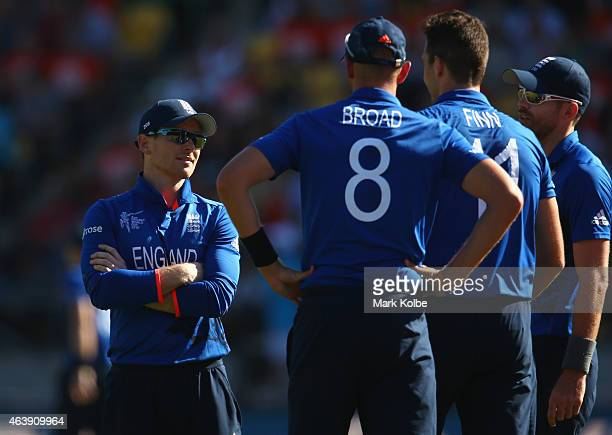 Eoin Morgan of England speaks to his bowlers Stuart Broad Steven Finn and James Anderson of England during the 2015 ICC Cricket World Cup match...