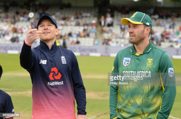 Eoin Morgan of England tosses the coin watched by AB de Villiers of South Africa before the 3rd Royal London oneday international cricket match...