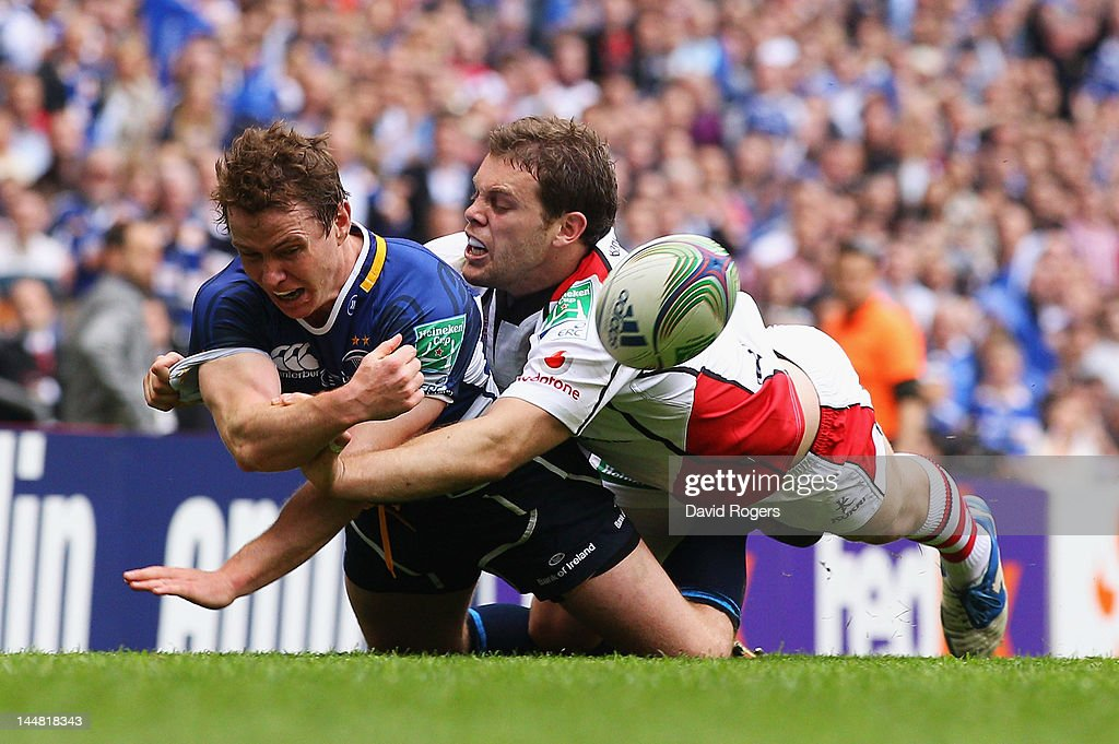 <a gi-track='captionPersonalityLinkClicked' href=/galleries/search?phrase=Eoin+Reddan&family=editorial&specificpeople=661020 ng-click='$event.stopPropagation()'>Eoin Reddan</a> of Leinster is tackled by Darren Cave of Ulster during the Heineken Cup Final between Leinster and Ulster at Twickenham Stadium on May 19, 2012 in London, United Kingdom.