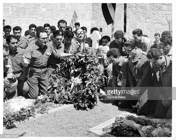 Eokamen kneel in front of the grave of a dead comrade during Eoka Day celebrations in NicosiaCyrus 1962