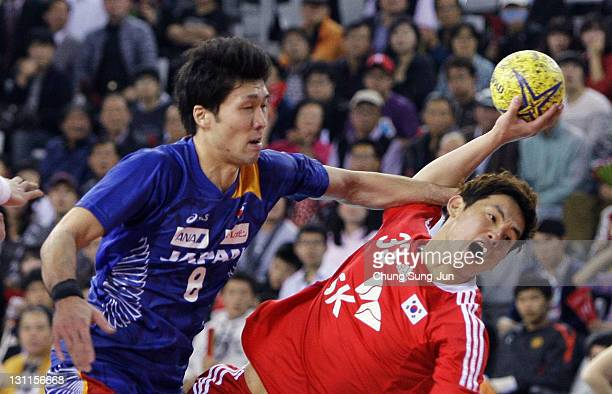 Eom HyoWon of South Korea throws a goal during the London Olympic Men's Handball Asian Qualifier Final match between Japan and South Korea at the...
