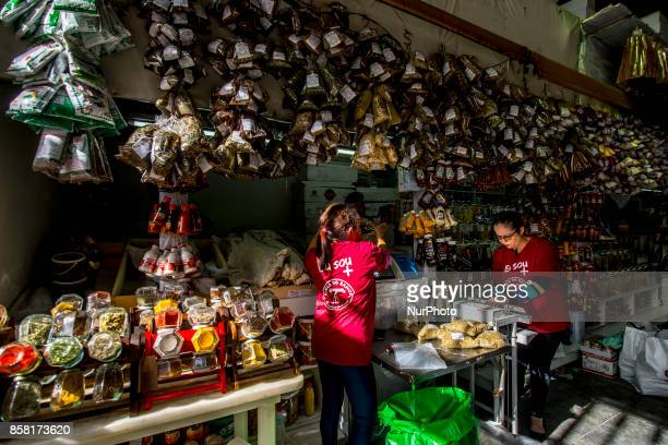 eople shop at the Municipal Market of Sao Paulo in downtown Sao Paulo Brazil October 5 2017 After the economy advanced in the second quarter...