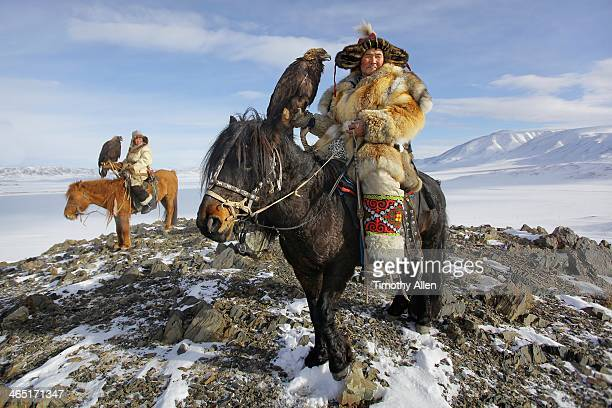 Epic Kazakh Golden Eagle hunters on horseback