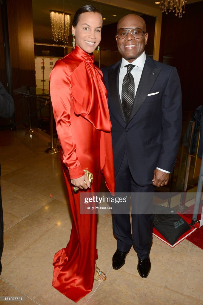 Epic Records Chairman/CEO Antonio 'L.A.' Reid (R) and <a gi-track='captionPersonalityLinkClicked' href=/galleries/search?phrase=Erica+Reid&family=editorial&specificpeople=669935 ng-click='$event.stopPropagation()'>Erica Reid</a> arrive at the 55th Annual GRAMMY Awards Pre-GRAMMY Gala and Salute to Industry Icons honoring L.A. Reid held at The Beverly Hilton on February 9, 2013 in Los Angeles, California.