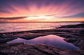 Epic sunset with beautiful color and sea at autumn evening in Porkkalanniemi, Finland