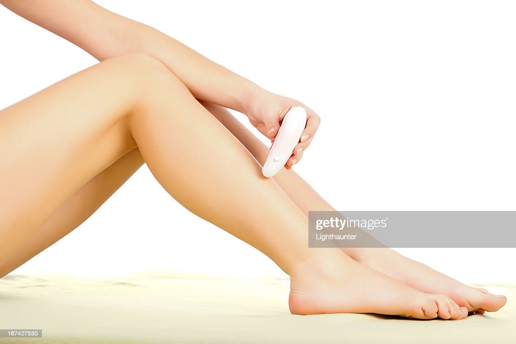 Epilating Legs : Stock Photo