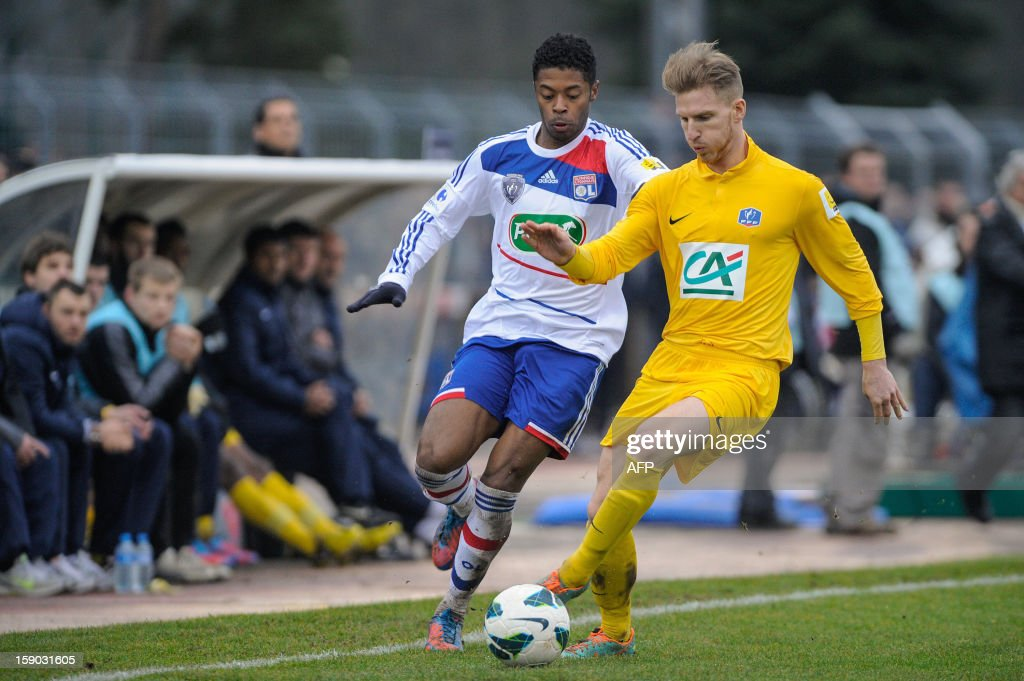 Epinal's French defender Judicael Crillon (R) vies with Lyon's Brazilian midfielder Michel Fernandes Bastos during their French cup football match Epinal (SAS) vs Lyon (OL) at the Colombiere Stadium in Epinal, on January 6, 2013.