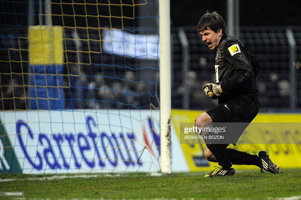 Epinal's French goalkeeper Olivier Robin celebrates after saving a penalty kick during the penalty shoutout of a French Cup round of 64 football match against Lyon at the Colombiere Stadium in Epinal on January 6, 2013.