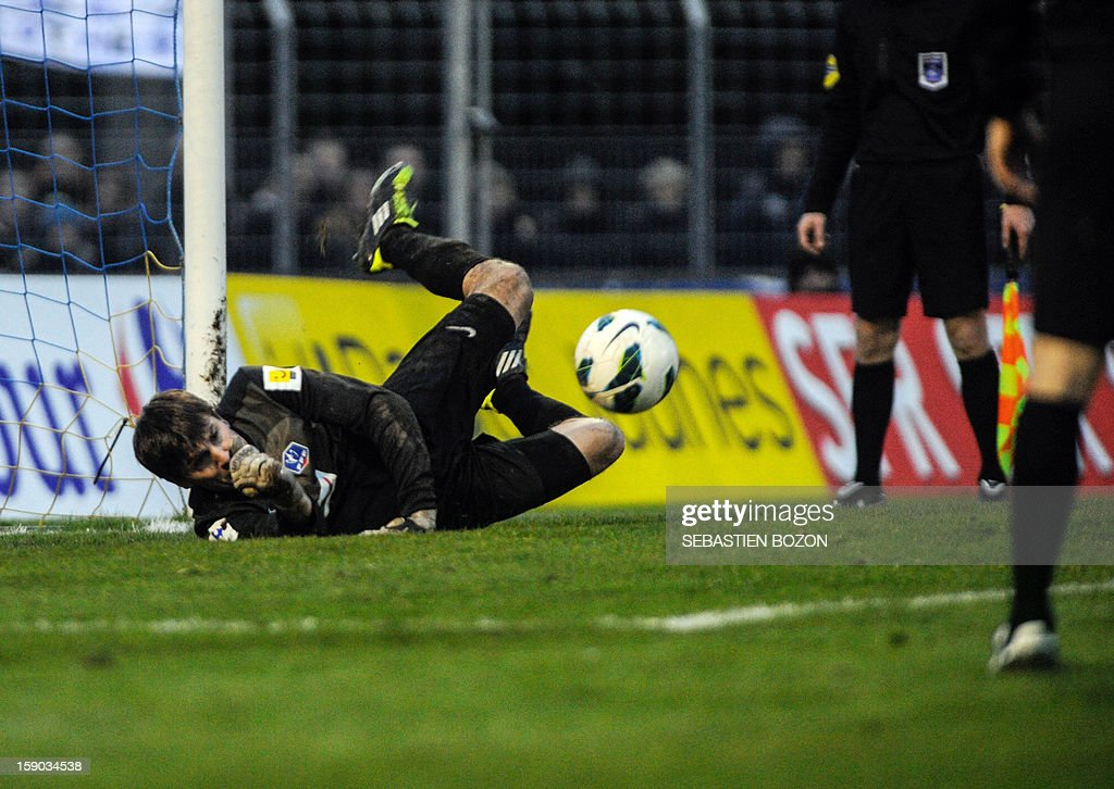 Epinal's French goalkeeper Olivier Robin saves a penalty kick during the penalty shoutout of a French Cup round of 64 football match against Lyon at the Colombiere Stadium in Epinal on January 6, 2013. AFP PHOTO / SEBASTIEN BOZON