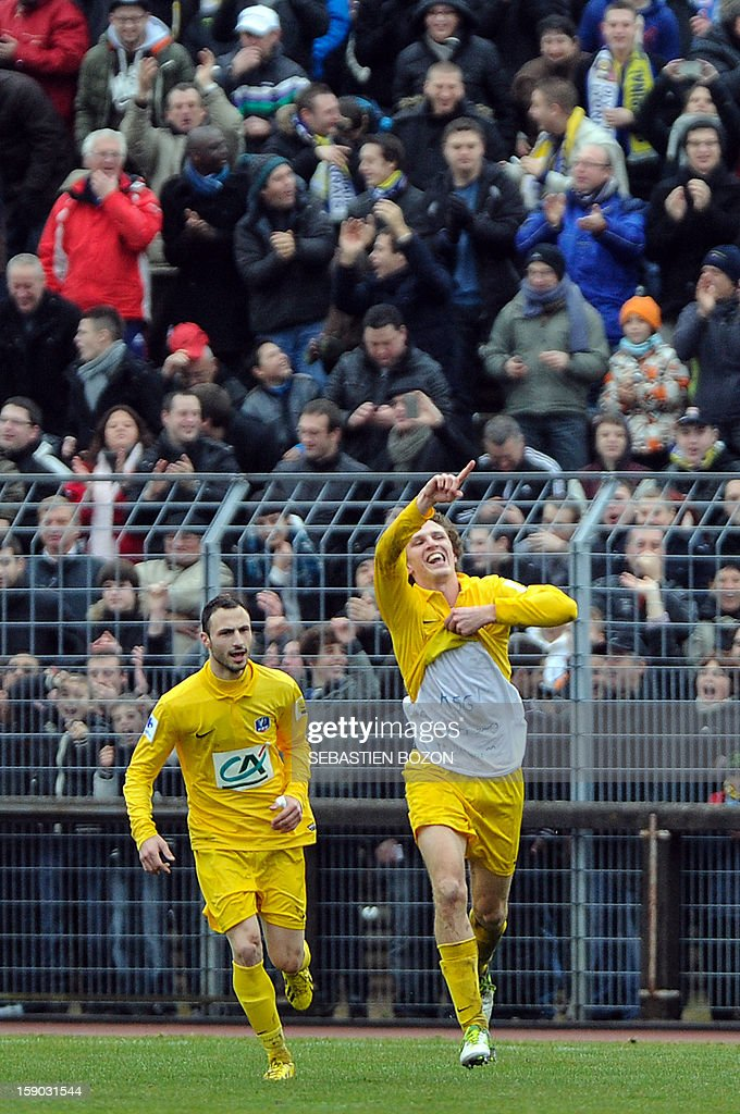 Epinal's French midfielder Tristan Boubaya (R) celebrates after scoring a goal during a French Cup football match between Epinal (SAS) and Lyon (OL) at the Colombiere Stadium in Epinal, on January 6, 2013. AFP PHOTO / SEBASTIEN BOZON
