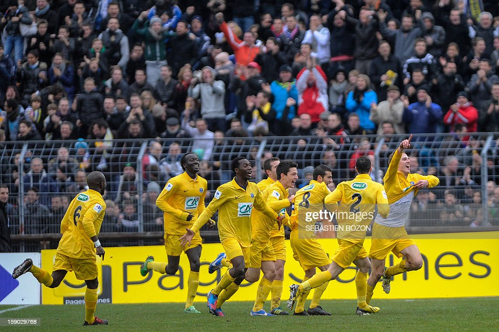 Epinal's French midfielder Tristan Boubaya (R) jubilates after scoring a goal during their French cup football match Epinal (SAS) versus Lyon (OL) at the Colombiere Stadium in Epinal, on January 6, 2013.