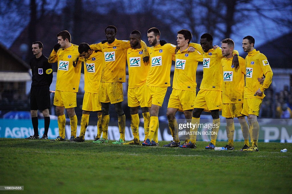 Epinal's player stand during the penalty shoutout of a French Cup round of 64 football match against Lyon at the Colombiere Stadium in Epinal on January 6, 2013.