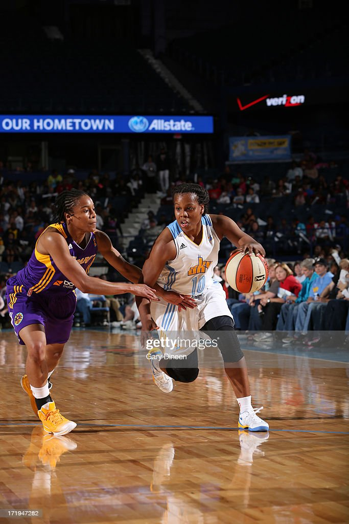 Epiphanny Prince of the Chicago Sky drives against A'dia Mathies of the Los Angeles Sparks during the game on June 29 2013 at the Allstate Arena in...