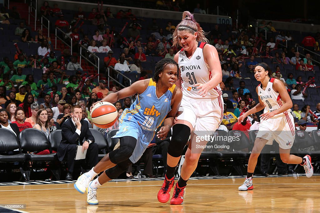 Epiphanny Prince #10 of the Chicago Sky drives against Stefanie Dolson #31 of the Washington Mystics at the Verizon Center on August 13, 2014 in Washington, DC.