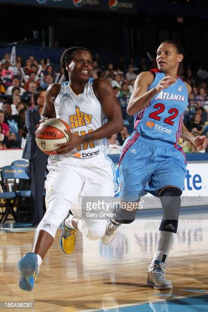 Epiphanny Prince of the Chicago Sky drives to the basket past Arminte Price of the Atlanta Dream on August 17 2012 at the Allstate Arena in Rosemont...